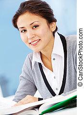 Pretty employee - Portrait of smiling businesswoman looking...