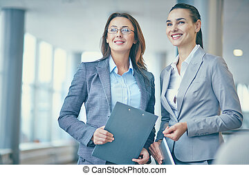 Pretty employees - Image of two confident businesswomen in...