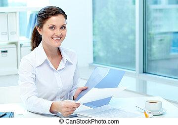 Pretty employer - Portrait of happy employer holding test...
