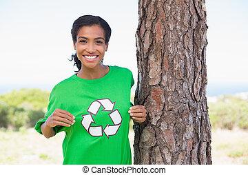 Pretty environmental activist showing her t-shirt