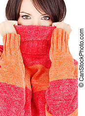 pretty eyes of a woman in wool sweater