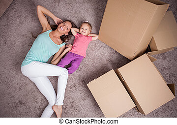Pretty family is in process of moving into new house