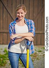Pretty farmer - Image of happy female farmer with instrument...