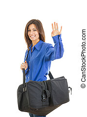 Pretty fashionable woman with large suitcase waving - Pretty...