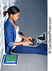 female african american student using laptop
