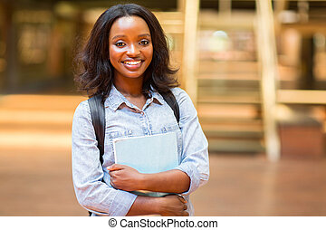 female african american university student with books
