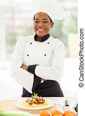 female african chef with arms crossed