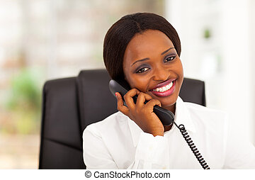 african office worker talking on phone