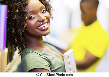 african uni student holding a book