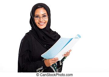female Arabic university student reading
