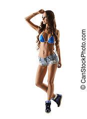 Pretty female athlete posing in sexy sportswear