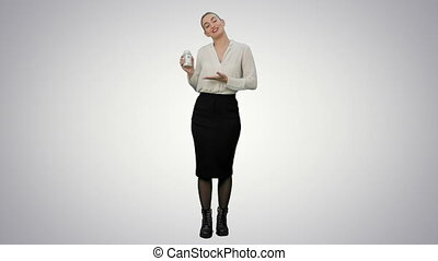 Pretty female businesswoman describing and advertising pills for the camera on white background.