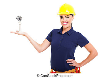 female cctv installer presenting camera - pretty female cctv...