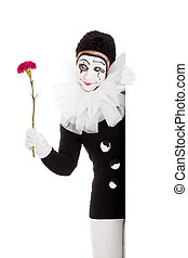 female clown with flower in hand