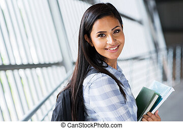 pretty female college student going to attend class