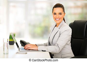 female corporate worker working in office