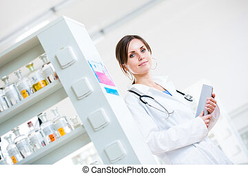Pretty, female doctor in a hospital lab (image with copy space;