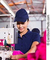 female factory worker sewing garment