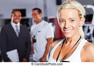 pretty female gym trainer closeup portrait
