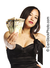 Pretty female in black dress displaying Canadian currency