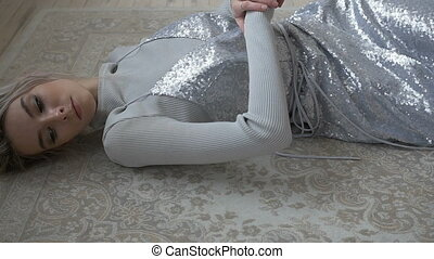Pretty female lying on the floor