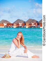 Pretty female on luxury beach resort