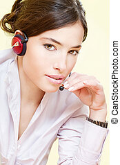pretty female operater with headphones