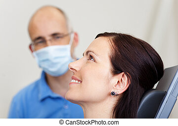 Pretty Female Patient Smiling In Dentistry