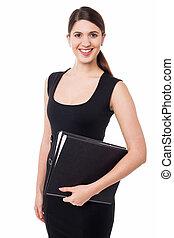 Pretty female secretary holding business files