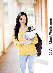 university student walking down school corridor