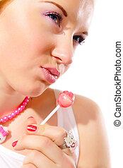 pretty female with lollipop