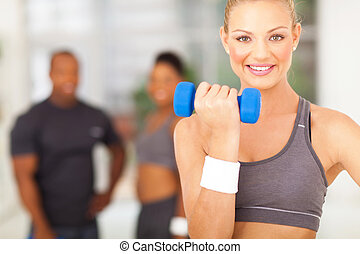 fit woman working out with dumbbell