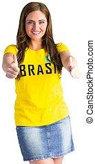 Pretty football fan in brasil t-shirt on white background
