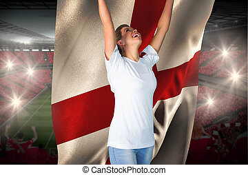 Pretty football fan in white cheering holding england flag...