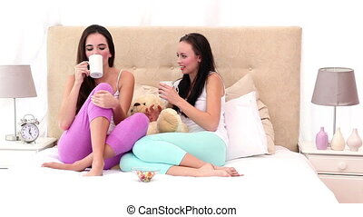 Pretty friends drinking coffee