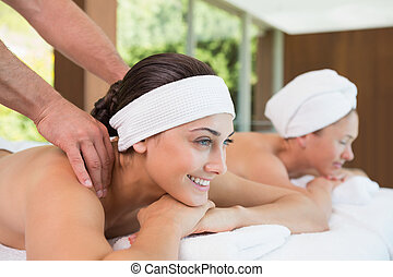 Pretty friends getting massages together