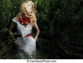 Pretty gentle blond hair woman over green bushes posing -...