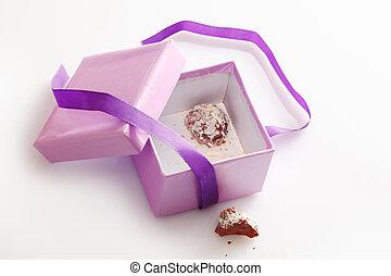Pretty gift box with last chocolate truffle