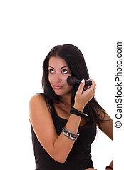 girl apply make-up on face