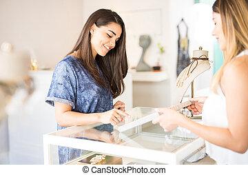 Pretty girl buying some jewelry
