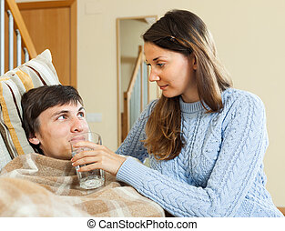 girl caring for sick young man