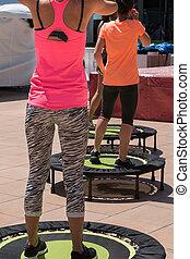 Pretty Girl doing Fitness on Mini Trampoline