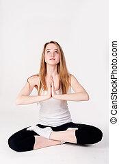 Pretty girl doing meditation exercise