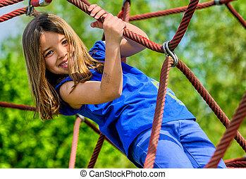 pretty girl doing rock climbing - portrait of pretty girl...