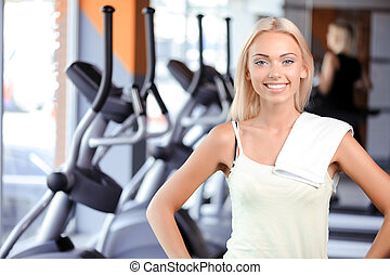 Pretty girl during fitness class