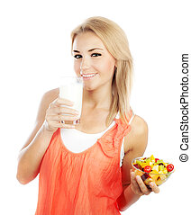 Pretty girl eating fruits and drinking milk