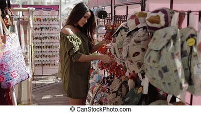 Pretty girl enjoying shopping - Young wonderful girl in...