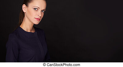 Beautiful woman over black background with copy space