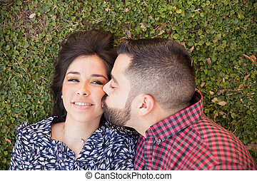 Pretty girl getting kissed