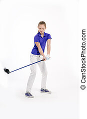 Pretty girl golfer swinging with diver on white backgroud in studio